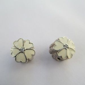 2 Authentic Pandora flower clips stamped
